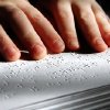 BLIND / BLINDNESS: Daniel Brookshire, a Tulsa eighth-grader, moves his fingers across words as he reads passages from one of the Braille volumes of the Bible in his family\'s home on Thursday, Jan. 7, 2010. Photo by Jim Beckel, The Oklahoman ORG XMIT: KOD