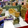 Carson Biggerstaff, right, takes part in the AGtropolis farmers market with the help of Robert Hofegartner at the Oklahoma State Fair at State Fair Park on Friday, Sept. 14, 2012, in Oklahoma City, Oklahoma. Photo by Chris Landsberger, The Oklahoman