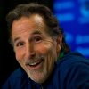 Photo - Vancouver Canucks' head coach John Tortorella laughs after a reporter mistakenly called him Mike during an end of season news conference in Vancouver, British Columbia on Monday April 14, 2014.  The Canucks missed the playoffs this year.  (AP Photo/The Canadian Press, Darryl Dyck)
