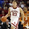 OU\'s Blake Griffin dribbles past UT\'s A.J. Abrams on a fast break in the first half during the Big 12 men\'s college basketball game between the University of Oklahoma and Texas at the Lloyd Noble Center in Norman, Okla., Monday, January 12, 2009. Photo By Nate Billings, The Oklahoman