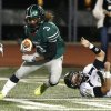 Norman North\'s Bryan Payne cuts past Broken Arrow\'s Justin Perkins in class 6A football on Friday, Nov. 16, 2012 in Norman, Okla. Photo by Steve Sisney, The Oklahoman