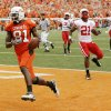 OSU\'s Justin Blackmon (81) scores on an 80-yard touchdown catch in front of Nebraska\'s DeJon Gomes (7), Prince Amukamara (21) and P.J. Smith (13) in the second quarter during the college football game between the Oklahoma State Cowboys (OSU) and the Nebraska Huskers (NU) at Boone Pickens Stadium in Stillwater, Okla., Saturday, Oct. 23, 2010. Photo by Nate Billings, The Oklahoman