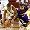 Oklahoma Sooners\' Jasmine Hartman (45) steals the ball from Northwestern State Lady Demons\' Janelle Perez (13) as the University of Oklahoma (OU) Sooner women\'s basketball team plays the Northwestern State Lady Demons at the Lloyd Noble Center on Thursday, Nov. 29, 2012 in Norman, Okla. Photo by Steve Sisney, The Oklahoman