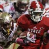 North Carolina State\'s Tobais Palmer runs the ball as Florida State\'s P.J. Williams (26) tries to make the tackle during the first half of an NCAA college football game in Raleigh, N.C., Saturday, Oct. 6, 2012. (AP Photo/Gerry Broome)