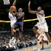 Atlanta\'s Jamal Crawford collides with Kevin Durant as he puts up a shot in front of Durant and Sere Ibaka during their NBA basketball game at the OKC Arena in Oklahoma City on Friday, Dec. 31, 2010. The Thunder beat the Hawks 103-94. Photo by John Clanton, The Oklahoman