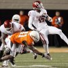 OU\'s Mossis Madu (17) is tripped up by OSU\'s Orie Lemon (41) in the fourth quarter during the Bedlam college football game between the University of Oklahoma Sooners (OU) and the Oklahoma State University Cowboys (OSU) at Boone Pickens Stadium in Stillwater, Okla., Saturday, Nov. 27, 2010. OU won, 47-41. Photo by Nate Billings, The Oklahoman