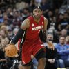 Miami Heat forward LeBron James picks up a loose ball against the Denver Nuggets in the first quarter of an NBA basketball game in Denver on Thursday, Nov. 15, 2012. (AP Photo/David Zalubowski)