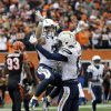 Photo - San Diego Chargers running back Danny Woodhead, left, celebrates his touchdown with wide receiver Keenan Allen in the first half of an NFL wild-card playoff football game against the Cincinnati Bengals, Sunday, Jan. 5, 2014, in Cincinnati. (AP Photo/Al Behrman)