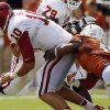 UT\'s Quandre Diggs (6) brings down Ou quarterback Blake Bell (10) in the second half during the Red River Rivalry college football game between the University of Oklahoma Sooners and the University of Texas Longhorns at the Cotton Bowl Stadium in Dallas, Saturday, Oct. 12, 2013. UT won, 36-20. Photo by Nate Billings, The Oklahoman