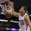 Photo - Los Angeles Clippers forward Blake Griffin dunks against the Oklahoma City Thunder during the first half of an NBA basketball game in Los Angeles, Wednesday, April 9, 2014. (AP Photo/Danny Moloshok)