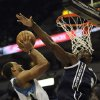 Photo - Oklahoma City Thunder's Serge Ibaka, of Congo, blocks a shot by Minnesota Timberwolves' Derrick Williams (7) during the second quarter of an NBA basketball game at the Target Center on Thursday, Dec. 20, 2012, in Minneapolis. (AP Photo/Hannah Foslien)