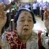 Lourdes Lacap with ashes in the sign of the cross on her forehead raises her hands in prayer as she join the others during a mass in observance of Ash at a Catholic church in suburban Quezon City north of Manila, Philippines, Wednesday, Feb. 22, 2012. Ash Wednesday marks the beginning of Lent, a time when Christians prepare for Easter through acts of penitence and prayer. (AP Photo/Pat Roque)