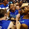 Photo - Florida Gulf Coast players celebrate after winning a third-round game against San Diego State in the NCAA college basketball tournament, Sunday, March 24, 2013, in Philadelphia. Florida Gulf Coast won 81-71. (AP Photo/Naples Daily News, Scott McIntyre) ORG XMIT: FLNAP101