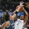 FIRST REGULAR SEASON WIN: Oklahoma City\'s Russell Westbrook tries to shoot over Mike Miller of Minnesota during the NBA basketball game between the Oklahoma City Thunder and the Minnesota Timberwolves at the Ford Center in Oklahoma City, Sunday, Nov. 2, 2008. The Thunder won, 88-85. BY NATE BILLINGS, THE OKLAHOMAN ORG XMIT: KOD