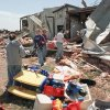 MAY 3, 1999 TORNADO: Tornado damage: Members of the Ridgecrest Baptist Church, in Bridge Creek, remove toys and furniture from the day-care center that was destroyed in Monday\'s tornado about 45 minutes after the kids left. Photo by David McDaniel