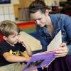 Photo -  Cooper Stephens, 4, and his mom, Johnna Kirkland, look at a book Thursday in the pre-K room at Wilson Elementary in Oklahoma City. Photo by Sarah Phipps, The Oklahoman   SARAH PHIPPS -