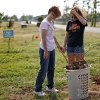 Photo - Kelly Pack and her daughter Bailey Pack, 18, pause as they clean up debris on their property from the May 20 tornado in Newcastle, Okla., Saturday, July 6, 2013. Chicago White Sox pitcher Hector Santiago bought Bailey's materials and sent her money so she could move to Stillwater to attend Oklahoma State University.