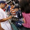 Oklahoma City\'s Collin Delome (5) signs autographs before the 2012 opening day baseball game between the Oklahoma City RedHawks and the Memphis Redbirds at the Chickasaw Bricktown Ballpark in Oklahoma City, Thursday, April 5, 2012. Photo by Nate Billings, The Oklahoman