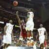 Oklahoma\'s Tommy Mason-Griffin (11) puts up a shot past Oklahoma State\'s Reger Dowell (5) in the first half of the college basketball game during the men\'s Big 12 Championship tournament at the Sprint Center on Wednesday, March 10, 2010, in Kansas City, Mo. Photo by Chris Landsberger, The Oklahoman