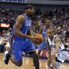 Oklahoma City\'s Lazar Hayward (11) drives to the basket by Dallas\' Jerome Randle during the pre season NBA game between the Dallas Mavericks and the Oklahoma City Thunder at the American Airlines Center in Dallas, Sunday, Dec. 18, 2011. Photo by Sarah Phipps, The Oklahoman