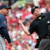 Photo - Atlanta Braves manager Fredi Gonzalez, left, is ejected from the game while arguing with home plate umpire Ron Kulpa, right, during the fifth inning of a baseball game against the St. Louis Cardinals on Saturday, May 17, 2014, in St. Louis. (AP Photo/St. Louis Post-Dispatch, Chris Lee)  EDWARDSVILLE INTELLIGENCER OUT; THE ALTON TELEGRAPH OUT