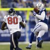 Photo - Indianapolis Colts free safety Darius Butler, right, intercepts a pass intended for Houston Texans wide receiver Andre Johnson during the first half of an NFL football game in Indianapolis, Sunday, Dec. 15, 2013. (AP Photo/AJ Mast)