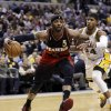 Photo - Atlanta Hawks forward Josh Smith, left, drives past Indiana Pacers forward Paul George during the first half of an NBA basketball game in Indianapolis, Tuesday, Feb. 5, 2013. (AP Photo/Michael Conroy)