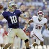 UW\'s Jake Locker (10) passes as OU\'s Travis Lewis (28) defends in the first half during the college football game between Oklahoma and Washington at Husky Stadium in Seattle, Wash., Saturday, September 13, 2008. BY NATE BILLINGS, THE OKLAHOMAN