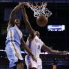 Denver\'s Kenneth Faried (35) dunks beside Oklahoma City\'s Serge Ibaka (9) during an NBA basketball game between the Oklahoma City Thunder and the Denver Nuggets at Chesapeake Energy Arena in Oklahoma City, Tuesday, March 19, 2013. Denver won 114-104. Photo by Bryan Terry, The Oklahoman