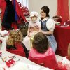 Lydia Huff, a senior at Edmond North High School, dressed as Belle from the Walt Disney film, Beauty and the Beast, and entertained patients at a tea party at the Jimmy Everest Center for Cancer and Blood Disorders Tuesday, Feb. 5, 2008. Morgan Snowden, 7, attended the tea party and sat on Huff\'s lap while she sang songs from the musical. Snowden, from Omega, is undergoing treatments for A.L.L. Leukemia, the same disease that Huff battled. Huff, who was diagnosed with leukemia at age 14 and now has been cancer free for one year, was chosen to play Belle in her school\'s production of Beauty and the Beast, The Musical, on March 6, 7, 8 and 9. BY JIM BECKEL, THE OKLAHOMAN
