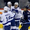 Photo - Tampa Bay Lightning's Teddy Purcell (16), Alex Killorn (17) and Valtteri Filppula (51) celebrate Filpula's goal against the Winnipeg Jets as Jets' Dustin Byfuglien (33) skates past during the first period of an NHL hockey game Tuesday, Jan. 7, 2014, in Winnipeg, Manitoba. (AP Photo/The Canadian Press, Trevor Hagan)