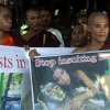 Buddhist monks hold banners as they stage a rally outside the Embassy of Bangladesh Friday, Oct. 5, 2012, in Yangon, Myanmar. More than 100 monks have demonstrated at Bangladesh's embassy to protest recent attacks against Buddhist temples and homes in Myanmar's South Asian neighbor. (AP Photo/Khin Maung Win)