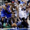 New York Knicks ll forward Carmelo Anthony (7) strips the ball away from Dallas Mavericks\' Elton Brand (42) in the first half of an NBA basketball game, Wednesday, Nov. 21, 2012, in Dallas. (AP Photo/Tony Gutierrez)