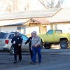 Photo - Modoc County Sheriff and Coroner Mike Poindexter, right, walks away from the Cedarville Rancheria tribal headquarters building in Alturas, Calif., on Friday, Feb. 21, 2014. Police say an eviction hearing at the headquarters turned deadly Thursday as a woman who once served as a tribal leader allegedly opened fire, killing four people and critically wounding two others in a gun and knife attack. (AP Photo/Jeff Barnard)
