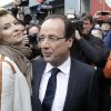 Photo -   Socialist Party candidate for the presidential election Francois Hollande and his companion Valerie Trierweiler leave after voting in the second round of the presidential election in Tulle, central France, Sunday, May 6, 2012. (AP Photo/Lionel Cironneau)