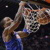 Photo - New York Knicks' J.R. Smith dunks against the Phoenix Suns during the first half of an NBA basketball game on Wednesday, Dec. 26, 2012, in Phoenix. (AP Photo/Matt York)