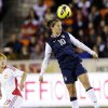 United States\' Carli Lloyd (10) heads the ball in front of China\'s Li Ying during the first half of an exhibition soccer match, Wednesday, Dec. 12, 2012, in Houston. (AP Photo/David J. Phillip)