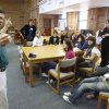 Baseball coach Jason Pickard talks to French exchange students about how baseball is played in America at a meeting in the library at Classen School of Advanced Studies in Oklahoma City Wednesday, April 15, 2009. The French students will attend an Oklahoma City RedHawks minor league baseball game this week while staying with hosts in Oklahoma. Photo by Paul B. Southerland, The Oklahoman