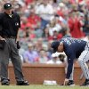 Photo - Atlanta Braves manager Fredi Gonzalez, right, points to home plate after being ejected from the game by home plate umpire Ron Kulpa, left, during the fifth inning of a baseball game against the St. Louis Cardinals on Saturday, May 17, 2014, in St. Louis. (AP Photo/Jeff Roberson)