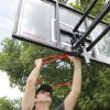 Photo - J. J. Gourley, Westminster Presbyterian Church deacon, puts together a basketball goal donated to a family raising foster children. <strong>PAUL B. SOUTHERLAND -  PAUL B. SOUTHERLAND </strong>