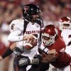 Texas Tech quarterback Graham Harrell (6) is in the grasp of Jeremy Beal during the second half of the college football game between the University of Oklahoma Sooners and Texas Tech University at the Gaylord Family -- Oklahoma Memorial Stadium on Saturday, Nov. 22, 2008, in Norman, Okla. BY STEVE SISNEY, THE OKLAHOMAN