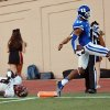 Photo - Duke's Issac Blakeney (17) scores on a pass from quarterback Anthony Boone as Elon's Miles Williams falls during an NCAA college football game Saturday, Aug. 30, 2014, in Durham, N.C.  (AP Photo/The Herald-Sun, Bernard Thomas)