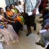 In this Dec. 10, 2012 photo, people wait to get their land registered at the government registrar\'s office in Hoskote 30 kilometers (19 miles) from Bangalore, India. For years, Karnataka\'s land records were a quagmire of disputed, forged documents maintained by thousands of tyrannical bureaucrats who demanded bribes to do their jobs. In 2002, there were hopes that this was about to change. (AP Photo/Aijaz Rahi)
