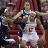 Photo - Maryland center Alicia DeVaughn (13) tries to protect the ball as she is guarded by Notre Dame forwards Ariel Braker, left, and Taya Reimer in the first half of an NCAA college basketball game in College Park, Md., Monday, Jan. 27, 2014. (AP Photo/Patrick Semansky)