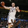 Oklahoma City\'s Nick Collison (4) grabs a rebound over Brandon Bass (32) fo Dallas in the first half during the NBA basketball game between the Dallas Mavericks and the Oklahoma City Thunder at the Ford Center in Oklahoma City, March 2, 2009. BY NATE BILLINGS, THE OKLAHOMAN ORG XMIT: KOD