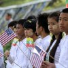 Photo -   Myanmar students hold Myanmar and U.S. flags as they wait to welcome the arrival of U.S. President Barack Obama at Yangon International Airport Monday, Nov. 19, 2012, in Yangon, Myanmar. (AP Photo/Khin Maung Win)