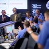 In this photo released by NASA, White House Science and Technology Advisor John Holdren, second from left, stops by the Mars Science Laboratory (MSL) Mission Support Area to meet the landing team and to say