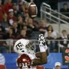 Texas A&M\'s Malcome Kennedy (84) tips up a pass that was intercepted by Oklahoma\'s Javon Harris (30) during the college football Cotton Bowl game between the University of Oklahoma Sooners (OU) and Texas A&M University Aggies (TXAM) at Cowboy\'s Stadium on Friday Jan. 4, 2013, in Arlington, Tx. Photo by Chris Landsberger, The Oklahoman