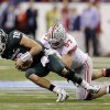 Photo - FILE - In this Dec. 7, 2013 file photo, Michigan State's Connor Cook (18) is sacked by Ohio State's Joey Bosa (97) during the first half of a Big Ten Conference championship NCAA college football game in Indianapolis. With Bosa, Noah Spence, Adolphus Washington and Michael Bennett up front and quality players behind them, the Buckeyes are hoping to erase the memory of a porous final few games in the 2013 season. (AP Photo/Darron Cummings, File)