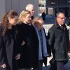 Photo - Kerry Kennedy, second from left, walks with her mother, Ethel Kennedy, third from left, as she leaves the Westchester County Courthouse, Friday, Feb. 28, 2014 in White Plains, N.Y. Kerry Kennedy was acquitted Friday of driving while impaired. after she accidentally took a sleeping pill on July 13, 2012 and then sideswiped a truck in a wild highway drive she said she didn't remember. The trial centered on whether or not she realized she was impaired and should have stopped.  (AP Photo/Jim Fitzgerald)